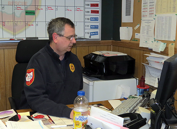 Chief Shawn Lynch working the desk